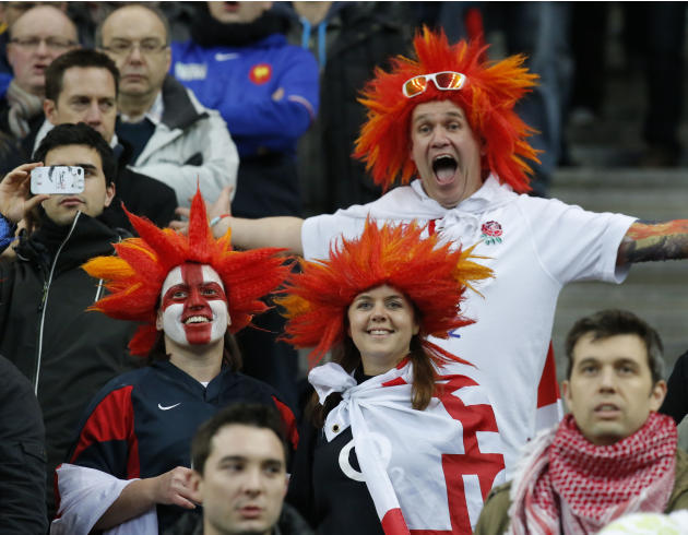 England's supporters cheer during the the British National anthem prior to a Six Nations international rugby union match between France and England at Stade de France stadium in Saint Denis, near