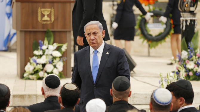 FILE - In this Wednesday, April 22, 2015 file photo, Israel's Prime Minister Benjamin Netanyahu leaves the podium after speaking during a Memorial Day ceremony to commemorate the country's fallen soldiers at Mount Herzl military cemetery in Jerusalem. With a little over 24 hours to go, Israeli Prime Minister Benjamin Netanyahu is scrambling to get his governing coalition together. Netanyahu has had a tough time striking deals with potential partners to form a majority coalition in the 120-seat parliament. If he fails by midnight Wednesday then President Reuven Rivlin will task someone else with the job. (Ammar Awad/Pool photo via AP, File)