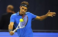 Roger Federer, pictured on October 13, began his bid for a sixth title at the Swiss Indoors by beating substitute opponent Benjamin Becker 7-5, 6-3 on Monday to reach the second round