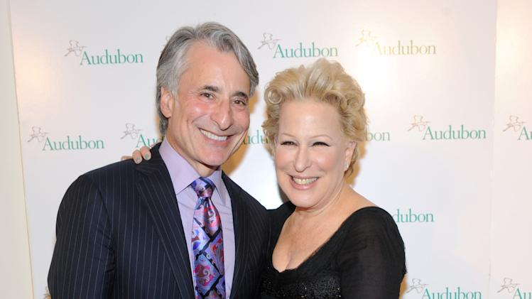 IMAGE DISTRIBUTED FOR THE NATIONAL AUDUBON SOCIETY - Bette Midler poses with David Yarnold, President & CEO, The National Audubon Society, at the organization's first gala to jointly award the Audubon Medal and the inaugural Dan W. Lufkin Prize for Environmental Leadership, Thursday, Jan. 17, 2013, in New York.  (Photo by Diane Bondareff/Invision for The National Audubon Society/AP Images)