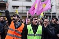 Members of the Kurdish community in France protest near the Kurdistan Information Bureau in Paris on January 10, 2013. A co-founder of the Kurdistan Workers' Party (PKK) and two other activists were found shot dead in Paris, a day after it emerged that Turkey and the jailed leader of the banned group were holding peace talks