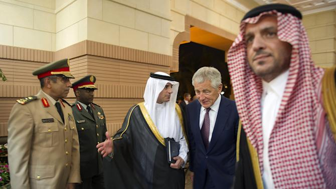 U.S. Secretary of Defense Chuck Hagel, center, is welcomed by Saudi ambassador to the United States Adel al-Jubeir, center left, as he arrives at the residence of Saudi Crown Prince, Deputy Premier and Minister of Defense Salman bin Abdulaziz in Riyadh, Saudi Arabia on Tuesday, April 23, 2013. (AP Photo/Jim Watson, Pool)
