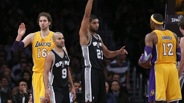 San Antonio Spurs Tim Duncan (2nd R) celebrates after making a shot as the Los Angeles Lakers Pau Gasol of Spain (L-R), Spurs Tony Parker of France, and Lakers Dwight Howard look on during their NBA basketball game in Los Angeles (Reuters)