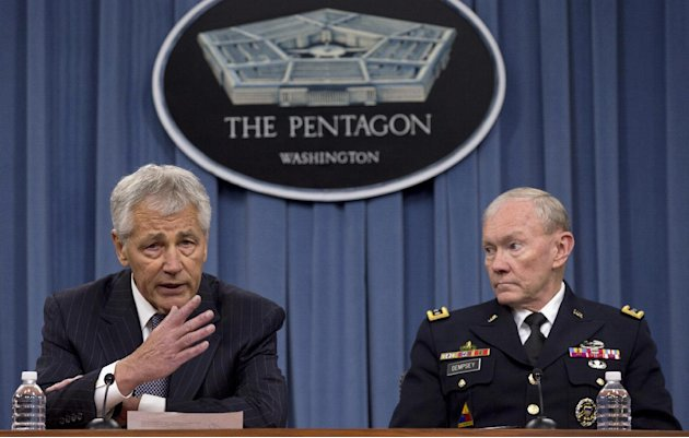 FILE – In this May 17, 2013 file photo Defense Secretary Chuck Hagel, left, and Chairman of the Joint Chiefs of Staff, Gen. Martin Dempsey take turns talking to media during a news conference at the P