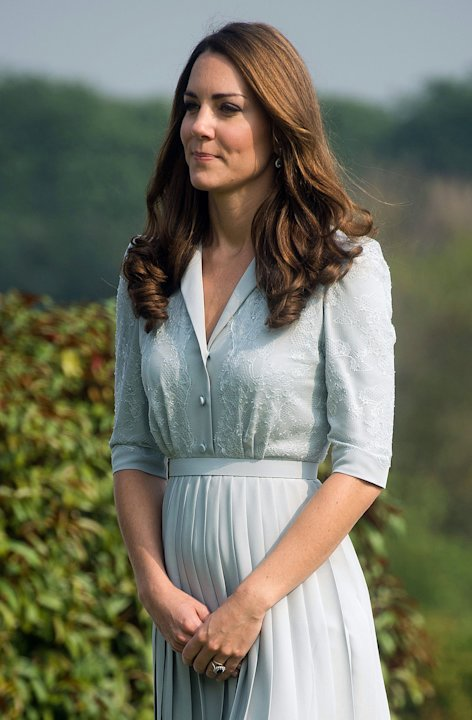FILE - In this Thursday, Sept. 13, 2012 file photo, Kate, the Duchess of Cambridge visits the Kranji Commonwealth War Memorial in Singapore.  Prince William and his wife Catherine are expecting their