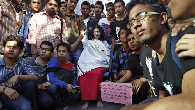 India's Irom Sharmila, center, who has been on a hunger strike for 12 years to protest an Indian law that suspends many human rights protections in areas of conflict, poses with supporters before a press conference, in New Delhi, India, Monday, March 4, 2013. Sharmila who has been force fed through a tube by authorities was charged Monday with attempted suicide in a case likely to bring major attention to her quiet protest in the tiny northeastern state of Manipur against the Armed Forces Special Powers Act. (AP Photo/Tsering Topgyal)