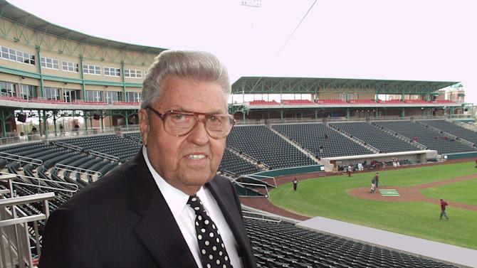 FILE - In a March 30, 2004 file photo, John Q. Hammons poses for a photo in his new 8,000 seat baseball stadium in Springfield, Mo. Hammons, a prominent hotel developer and southwest Missouri philanthropist, died Sunday, May 26, 2013 at a nursing home in Springfield, Mo., said Sheri Davidson Smith, a spokeswoman for John Q. Hammons Hotels & Resorts. He was 94. (AP Photo/John S. Stewart, File)