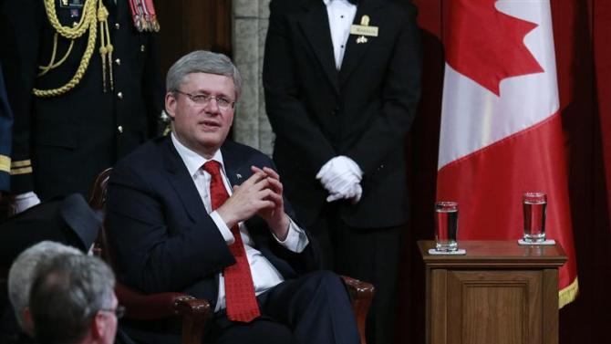 Canada's PM Harper waits for the start of the Speech from the Throne in the Senate chamber on Parliament Hill in Ottawa