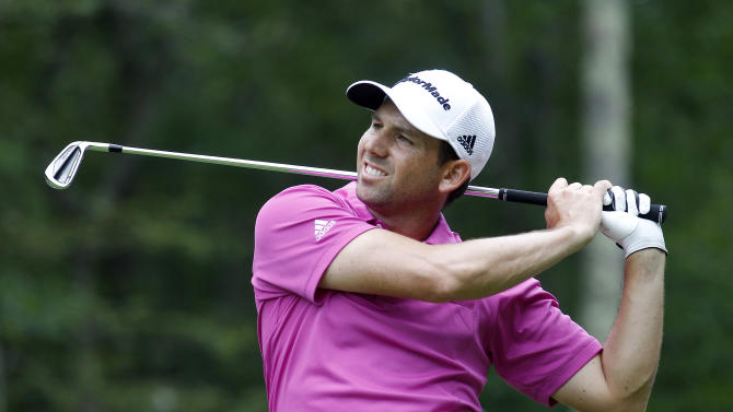 Sergio Garcia, form Spain, watches his tee shot on the eighth hole during the second round of the Deutsche Bank Championship golf tournament in Norton, Mass., Saturday, Aug. 31, 2013. (AP Photo/Stew Milne)