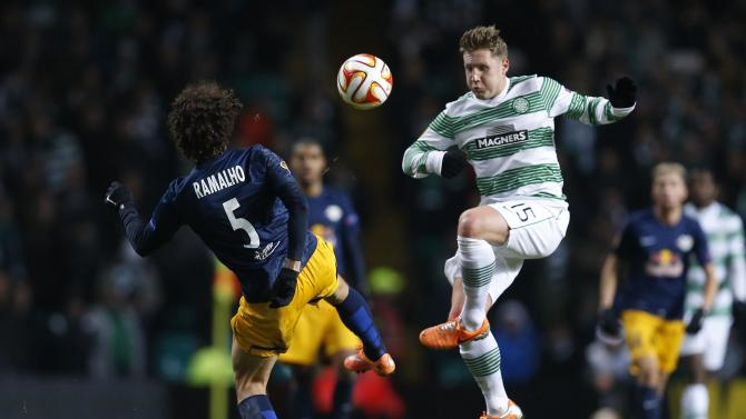 FC Salzburg's Andre Ramalho challenges Celtic's Kris Commons during their Europa League Group D soccer match at Celtic Park Stadium in Glasgow