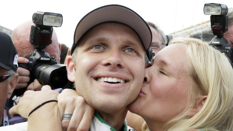 Ed Carpenter gets a kiss from his wife, Heather, after he won won the pole for the Indianapolis 500 auto race, at Indianapolis Motor Speedway in Indianapolis, Saturday, May 18, 2013. Carpenter won the pole with a speed of 228.762 mph. (AP Photo/AJ Mast)