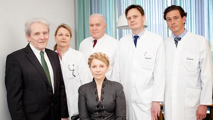 L-R: Chairman of the Executive Board of Charite Berlin Karl Max Einhaeupl, attending doctors Anett Reisshauer, Nobert Haas, Matthias Endres, Peter Vajkoczy standing behind Ukraine's Yulia Tymoshenko in Berlin, on March 8, 2014
