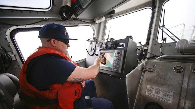 This photo taken Jan. 28, 2014, shows a Coast Guard officer following traffic on his screen while facing a dense fog which is almost completely eliminating visibility during a patrol off the San Diego coast in San Diego. With the drug war locking down land routes across Latin America and at the U.S. border, smugglers have been increasingly using large vessels to carry multi-ton loads of cocaine and marijuana hundreds of miles offshore, where the lead federal agency with extensive law enforcement powers is the Coast Guard, a military service roughly the size of the New York Police Department. (AP Photo/Lenny Ignelzi)