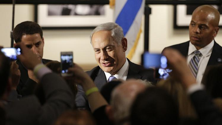"Israeli Prime Minister Benjamin Netanyahu, center, shakes hands with supporters before the screening of the television documentary ""Israel: The Royal Tour"" at Paramount Studios on Tuesday, March 4, 2014, in Los Angeles. Netanyahu flew Tuesday from Washington, D.C., to California, trading a focus on the geopolitics of the Middle East for a Hollywood screening and visits with Silicon Valley tech entrepreneurs. (AP Photo/Jae C. Hong)"