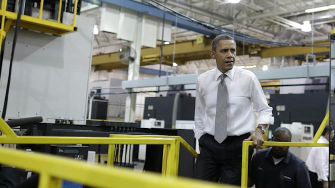 President Barack Obama visits Linamar Corporation in Arden, N.C., the day after delivering his State of the Union address, Wednesday, Feb. 13, 2013. (AP Photo/Charles Dharapak)