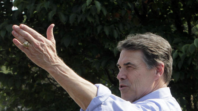 Republican presidential candidate, Texas Gov. Rick Perry, speaks to guests at a house party, Saturday, Sept. 3, 2011, in Manchester, N.H. (AP Photo/Jim Cole)