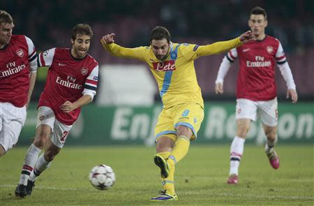 Napoli's Gonzalo Higuain kicks the ball to score against Arsenal during their Champions League soccer match at San Paolo stadium in Naple