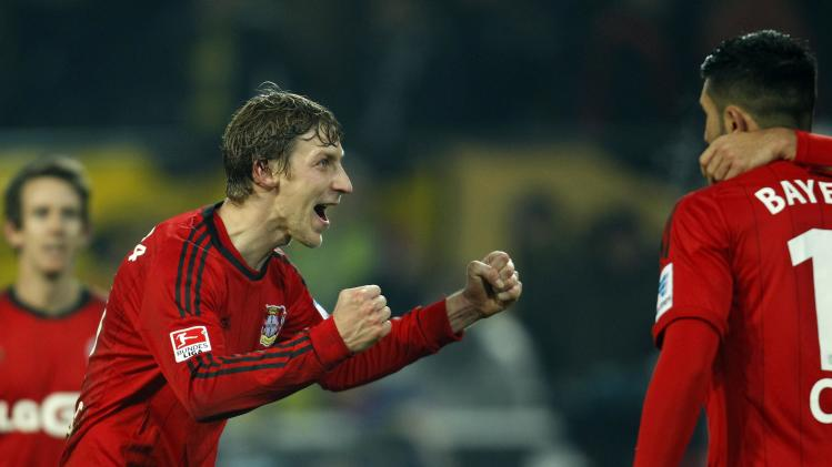 Bayer Leverkusen's Stefan Kiessling celebrates victory against Borussia Dortmund in their German first division Bundesliga soccer match in Dortmund