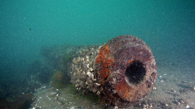 This photo shot by Sgt. Ken Stiel and provided by the Detroit Police department shows a cannon believed to be more than 200 years old in the Detroit River. Divers planned on recovering the cannon on Wednesday, Sept. 7, 2011 before murky waters and a strong current forced a cancellation of the project. It's the fifth cannon found in the area in three decades.  (AP Photo/Detroit Police, Sgt. Ken Stiel)