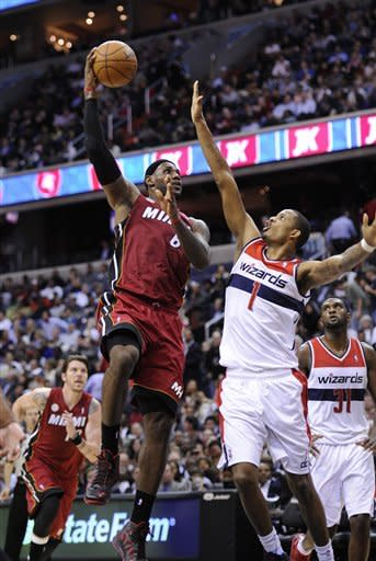 Wizards beat Heat 105-101 for 2nd win of season