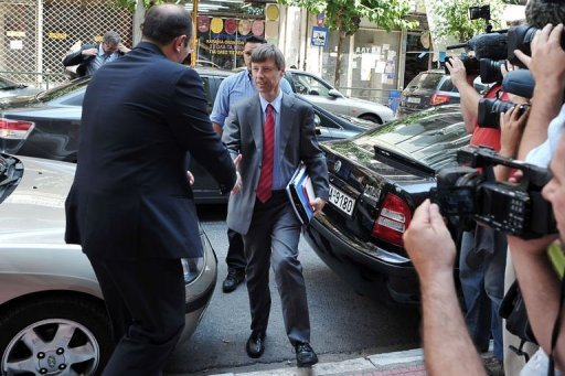 <p>European Union official Matthias Mors (C) is greeted while arriving at the Health Ministry in Athens. The new Greek government presents plans to salvage its debt rescue programme, aiming to appease EU-IMF auditors and gain some room to renegotiate the tough austerity terms with its creditors.</p>
