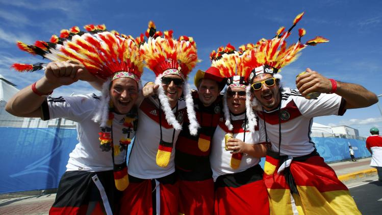 Germany fans pose before the 2014 World Cup Group G soccer match between Germany and Ghana at the Castelao arena