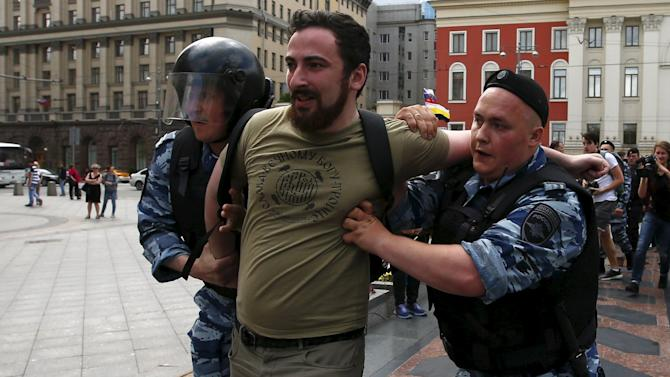 Policemen detain leader of Orthodox group God's Will Enteo during LGBT community rally in central Moscow