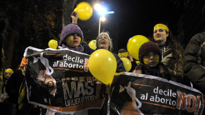 "People demonstrate against abortion legalization in downtown Montevideo, Uruguay, Monday, Sept. 24, 2012. Demonstrators protested the day before a congressional bill legalizing abortion is voted on. The signs read in Spanish ""not to abortion."" (AP Photo/Matilde Campodonico)"