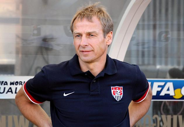 In this June 18, 2013 file photo, United States national soccer team head coach Jurgen Klinsmann stands on the pitch before a World Cup qualifying soccer match against Honduras at Rio Tinto Stadium in