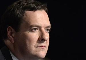 Britain's Chancellor of the Exchequer, Osborne listens on the first day of the Conservative Party annual conference in Manchester northern England