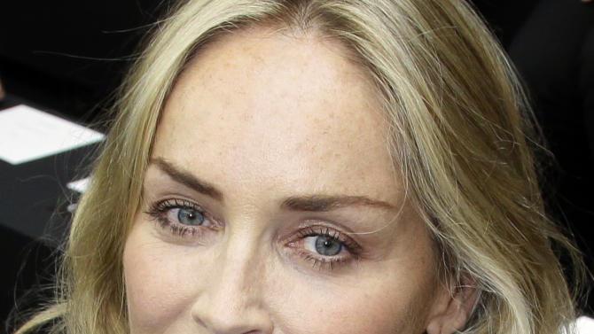 Sharon Stone attends the show of Belgian fashion designer Kris Van Assche for Dior as part of the Men's Spring-Summer 2013 collection, for the Paris Fashion Week, in Paris, France, Saturday, June 30, 2012. (AP Photo/Francois Mori)