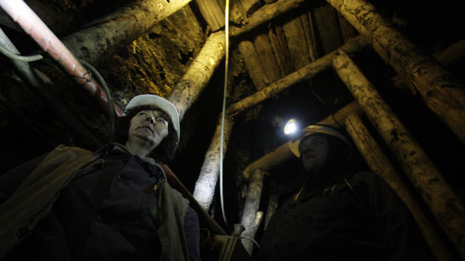 Women coal miners Semsa Hadzo, left, and Sakiba Colic, right, Bosnian coal technologists, walk through the underground tunnels of the coal mine in Breza, 20 kms north of Sarajevo, Bosnia, on Wednesday, Jan. 16, 2013.  The mine in Breza is the only one in Bosnia where a group of women work deep underground in the coal mines alongside their male colleagues, a legacy of communism, but they're set to retire in three years, marking the end of an era for this community where almost everybody is connected to the coal mine. The shafts and elevators echo with laughter and tales of their grandchildren as women miners work alongside their male counterparts.(AP Photo/Amel Emric)