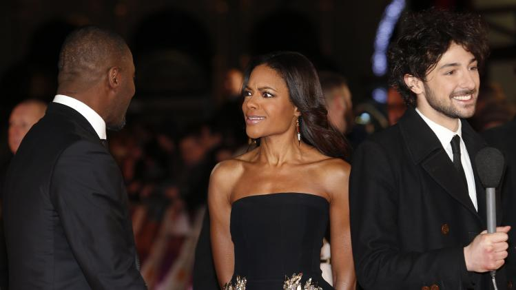 "Actress Naomie Harris reacts as she talks with fellow cast member Idris Elba before an interview at the Royal Premiere of ""Mandela: Long Walk to Freedom"" in London"