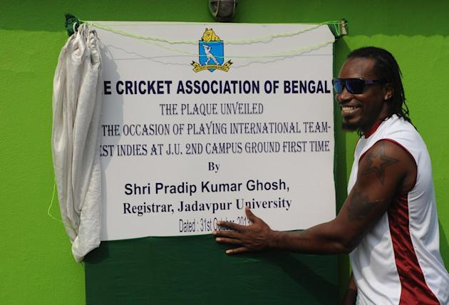 West Indian cricketer Chris Gayle inaugurates a cricket ground, at Jadavpur University's Salt Lake campus in Kolkata on Oct.31, 2013. (Photo: IANS)