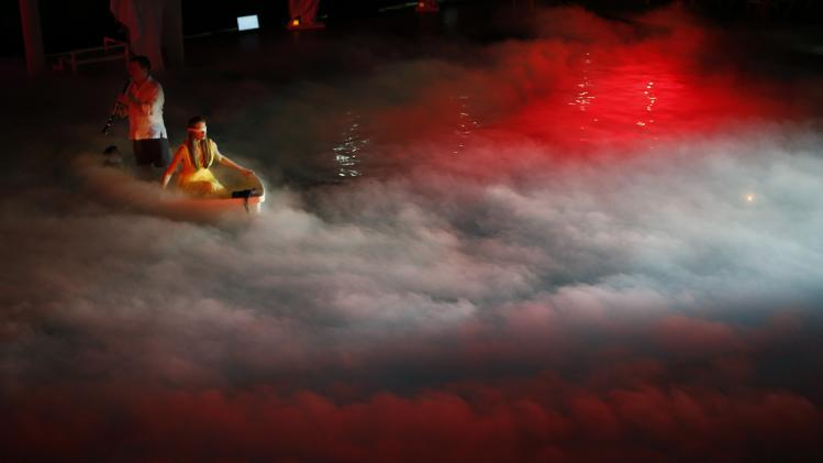 "Valerie Vinvant and Todd Palmer perform in a boat in Chicago Opera Theater's production of ""Orpheus & Euridice"" during a rehearsal at the Welles Park swimming pool in Chicago"
