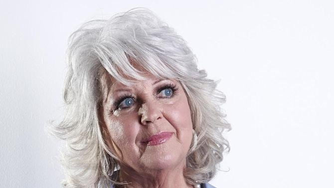 """FILE - In this Jan. 17, 2012 file photo, celebrity chef Paula Deen poses for a portrait in New York. The celebrity chef dissolved into tears during a """"Today"""" show interview Wednesday, June 26, 2013, trying to explain she wasn't a racist despite saying in a legal deposition that she's used racial slurs in the past. (AP Photo/Carlo Allegri, File)"""