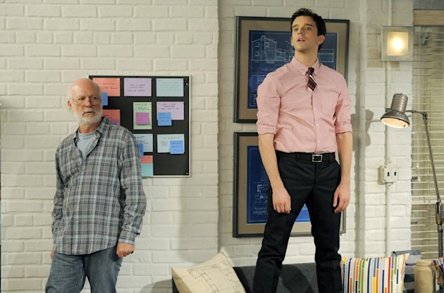 James Burrows, left, director of the television series &quot;Partners,&quot; plans a scene alongside cast member Michael Urie on Wednesday, Sept. 19, 2012, at Warner Bros. Studios in Burbank, Calif. Burrows isn&#39;t a household name. But behind the scenes Burrows reigns as a comedy giant. He&#39;s a director whose brand of funny business has helped shape TV comedy season after season. (Photo by Chris Pizzello/Invision/AP)