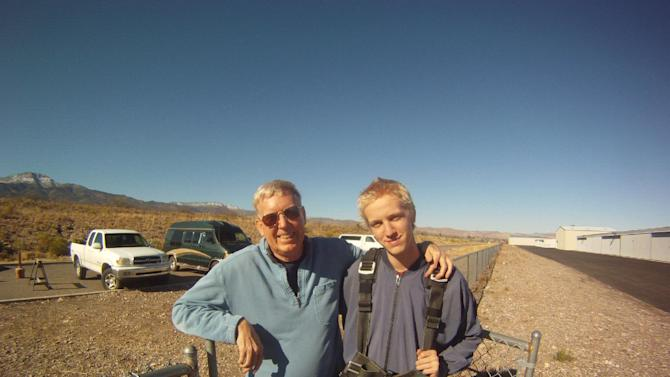 This Dec. 2012 photo provided by Jonathan Clark shows Dr. Jonathan Clark, husband of Columbia astronaut Laurel Clark, stands with his son, Iain Clark, 18, in Arizona. Clark's wife and six other astronauts, Commander Rick Husband, co-pilot William McCool, Kalpana Chawla, Michael Anderson, Dr. David Brown and Israeli Ilan Ramon, were killed in the final minutes of their 16-day scientific research mission aboard the space shuttle Columbia on Feb. 1, 2003.  Iain is set to graduate this spring from a boarding school in Arizona; he wants to study marine biology at a university in Florida.(AP Photo/Jonathan Clark)