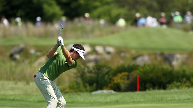 Keegan Bradley hits his second shot on the second hole during the first round of the Deutsche Bank Championship PGA golf tournament at TPC Boston in Norton, Mass., Friday, Aug. 31, 2012. (AP Photo/Stew Milne)
