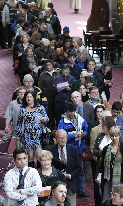FILE - In this March 7, 2012, file photo, job seekers stand in line during a Career Expo job fair, in Portland, Ore. The Labor Department said Friday, May 4, 2012, that the economy added just 115,000 