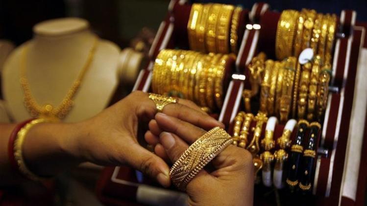 Woman wears gold bangle at jewellery shop in Siliguri