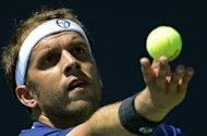 Two-time champion Jurgen Melzer suffered his earliest defeat in five years at the Austrian Open on Wednesday as the fourth seed went out in the second round, losing to Gilles Muller, pictured in August 2012, 6-3, 3-6, 7-6 (7/4)