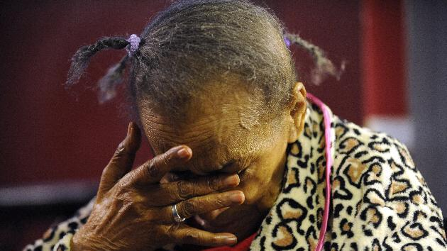In this Oct. 3, 3011, photo, Texana Hollis, 101, reacts after discussing her eviction in Detroit. Hollis, was evicted from her home in September because her son, Warren, failed to keep up with mortgage payments. After the eviction, Hollis collapsed and went to the hospital. The U.S. Department of Housing and Urban Development  said she could stay in the home as long as she wanted, but she has yet to move back in because the home is not in a livable condition. (AP Photo/Detroit News, John T. Greilick)  DETROIT FREE PRESS OUT