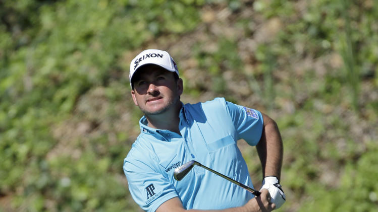 Graeme McDowell, of Northern Ireland, drives on the sixth hole in the second round of the Northern Trust Open golf tournament at Riviera Country Club in the Pacific Palisades area of Los Angeles Friday, Feb. 15, 2013. (AP Photo/Reed Saxon)