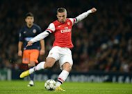 "Arsenal's German striker Lukas Podolski plays against Montpellier at the Emirates Stadium in London on November 21, 2012. Podolski has said he is relishing the chance to ""rock"" the Gunners alongside his Germany team-mate Mesut Ozil after the latter signed a five-year deal"