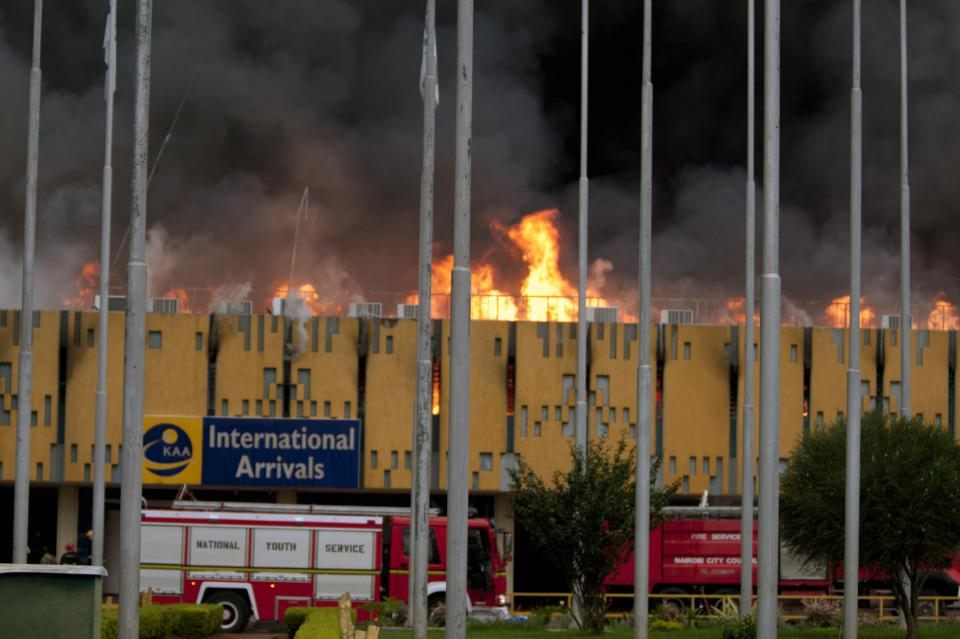A blaze rages the International arrivals hall at Jomo Kenyatta International Airport in Nairobi, Kenya Wednesday, Aug. 7, 2013. The Kenya Airports Authority said the Kenya's main international airport has been closed until further notice so that emergency teams can battle the fire. (AP Photo/Sayyid Azim)