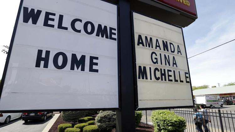 A welcome home sign is posted at a restaurant near a crime scene where three women were held captive for a decade in Cleveland, Ohio, Thursday, May 9, 2013.  Castro, a 52-year-old former school bus driver,  is charged with rape and kidnapping for allegedly abducting three women and holding them captive in his home.   (AP Photo/David Duprey)