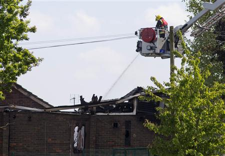 Firemen attend the scene of a fire at the Al-Rahma Islamic Centre in north London, June 5, 2013. REUTERS/Neil Hall