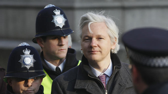 Julian Assange, the 40-year-old WikiLeaks founder, arrives at the Supreme Court in London,  Wednesday, Feb. 1, 2012. Assange's legal team is making a final effort at Britain's Supreme Court to avoid his extradition to Sweden. Assange is wanted by Swedish authorities over sex crimes allegations stemming from a visit to the country in 2010. He denies any wrongdoing.(AP Photo/Kirsty Wigglesworth)