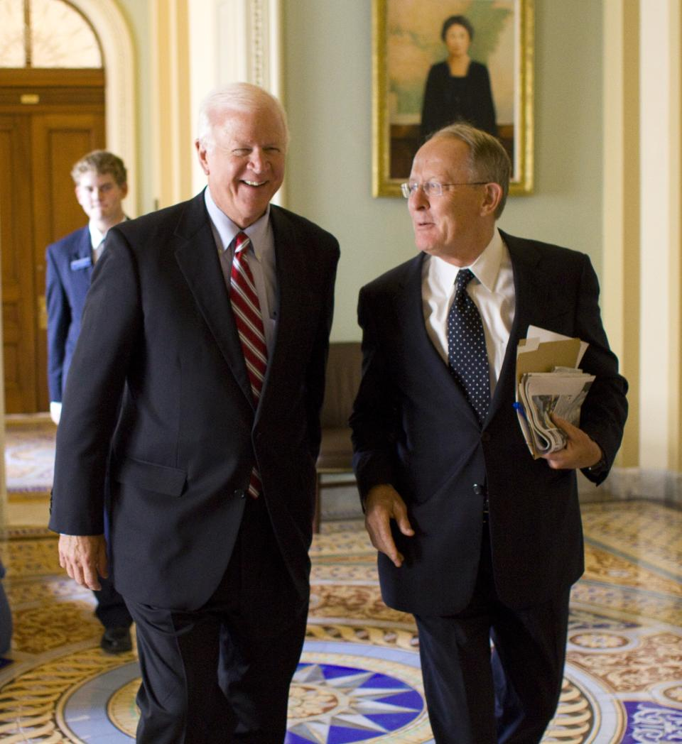 Sen. Saxby Chambliss, R-Ga., one of the so-called Gang of 6, walks with Sen. Lamar Alexander, R-Tenn.,  outside of the Senate Chamber, on Capitol Hill in Washington on Wednesday, July 20, 2011.(AP Photo/Harry Hamburg)